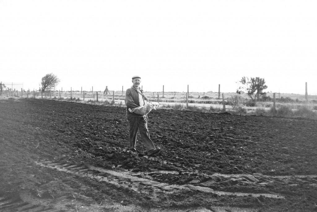 1970 - George (Geordie) Towns hand sowing seeds.