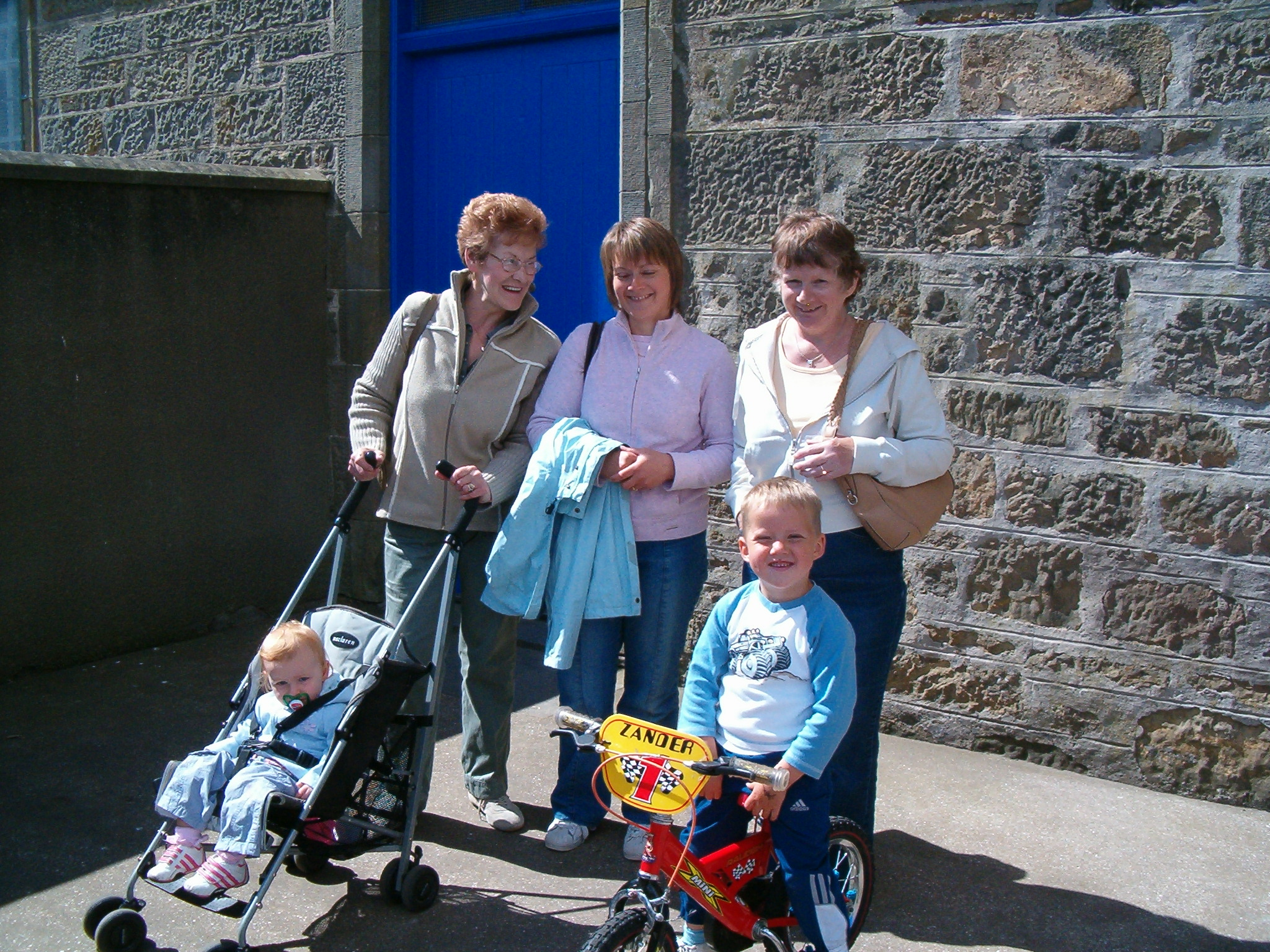 2008 - Jessie Bruce, Janice Craib & Helen McPherson with David & Alexander Craib outside church playschool.