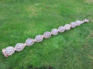 Glass ball floats secured with double twine netting.